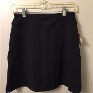 (2159). Athleta black skort.  Size XS.  NWT